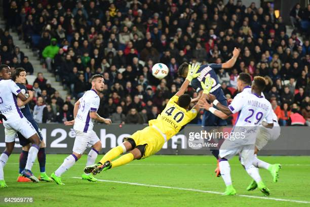 Goalkeeper Alban Lafont of Toulouse tries to block a header from Marquinhos of PSG during the French Ligue 1 match between Paris Saint Germain and...