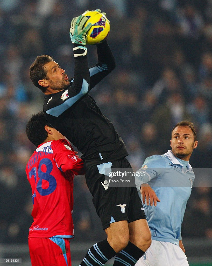 Goalkeeper Albano Bizzarri of SS Lazio grabs the ball between team-mate <a gi-track='captionPersonalityLinkClicked' href=/galleries/search?phrase=Stefan+Radu&family=editorial&specificpeople=4050253 ng-click='$event.stopPropagation()'>Stefan Radu</a> (R) and Pablo Barrientos of Calcio Catania during the TIM Cup match between S.S. Lazio and Calcio Catania at Stadio Olimpico on January 8, 2013 in Rome, Italy.