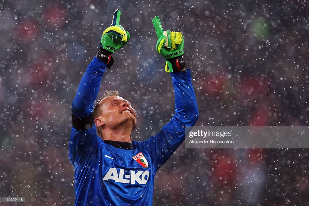 Goalkeeper <a gi-track='captionPersonalityLinkClicked' href=/galleries/search?phrase=Alexander+Manninger&family=editorial&specificpeople=167082 ng-click='$event.stopPropagation()'>Alexander Manninger</a> of Augsburg celebrates during the Bundesliga match between FC Augsburg and 1899 Hoffenheim at SGL Arena on February 1, 2015 in Augsburg, Germany.