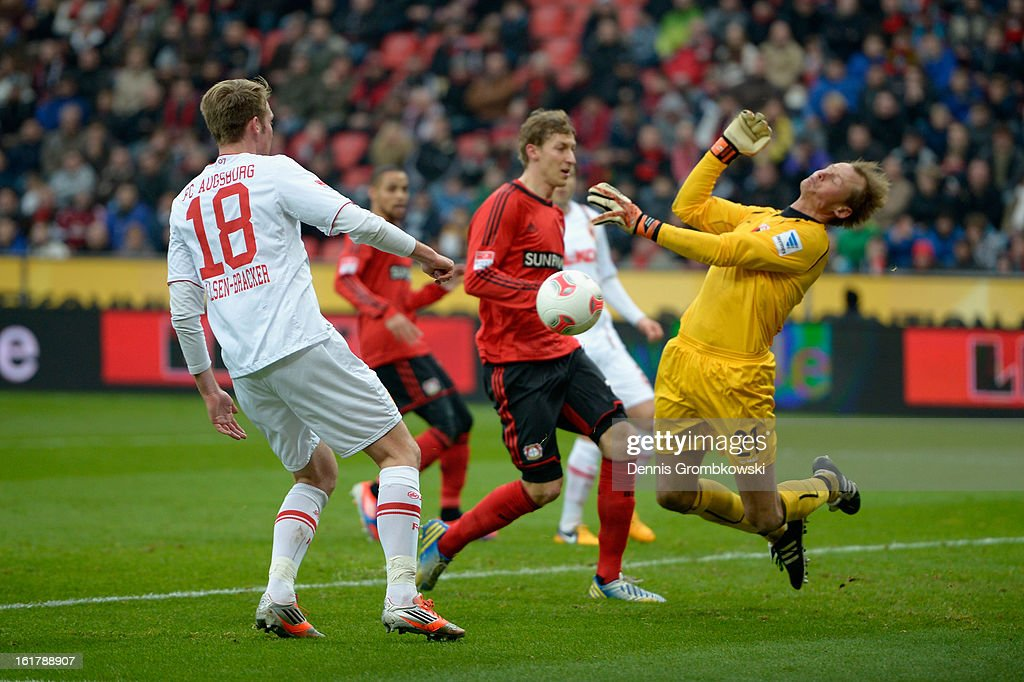 Goalkeeper <a gi-track='captionPersonalityLinkClicked' href=/galleries/search?phrase=Alexander+Manninger&family=editorial&specificpeople=167082 ng-click='$event.stopPropagation()'>Alexander Manninger</a> of Augsburg does a save during the Bundesliga match between Bayer 04 Leverkusen and FC Augsburg at BayArena on February 16, 2013 in Leverkusen, Germany.