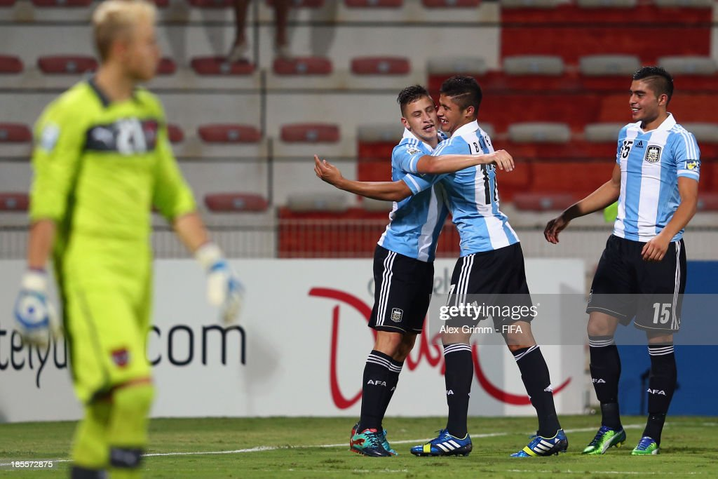 Goalkeeper Alexander Schlager of Austria reacts as German Ferreyra of Argentina celebrates his team's second goal with team mates Joaquin Ibanez and Rodrigo Moreira (L-R) during the FIFA U-17 World Cup UAE 2013 Group E match between Argentina and Austria at Al Rashid Stadium on October 22, 2013 in Dubai, United Arab Emirates.