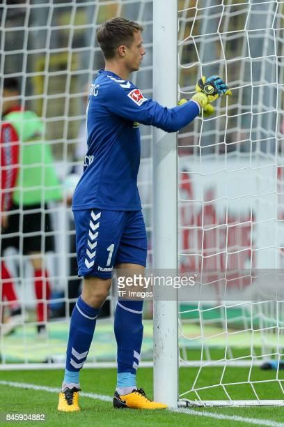 Goalkeeper Alexander Schwolow of Freiburg controls the ball during the Bundesliga match between SportClub Freiburg and Borussia Dortmund at...