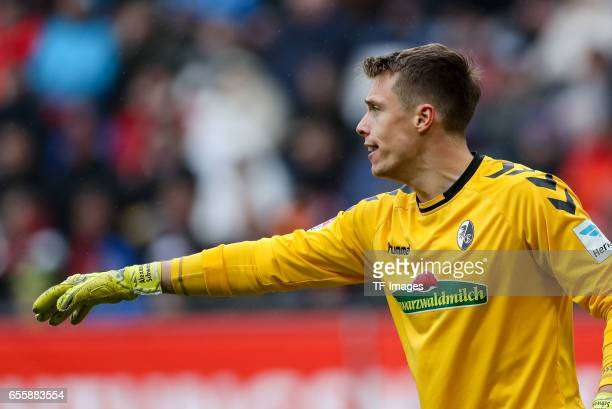 Goalkeeper Alexander Schwolow of Freiburg gestures during the Bundesliga match between FC Augsburg and SC Freiburg at WWK Arena on March 18 2017 in...