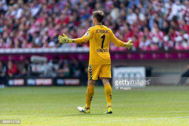 Goalkeeper Alexander Schwolow of Freiburg gestures during the Bundesliga match between Bayern Muenchen and SC Freiburg at Allianz Arena on May 20...