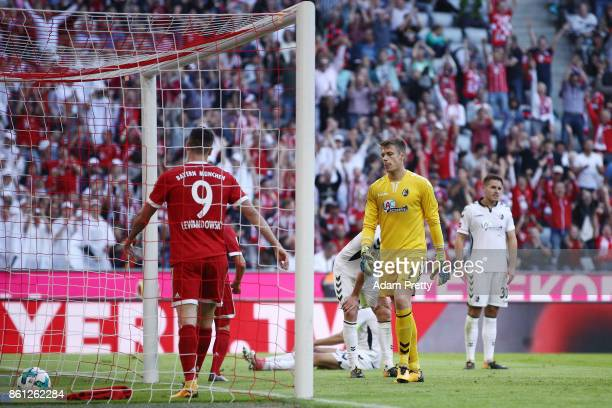 Goalkeeper Alexander Schwolow of Freiburg looks dejected after Joshua Kimmich of Bayern Muenchen scored his teams fifth goal to make it 50 during the...