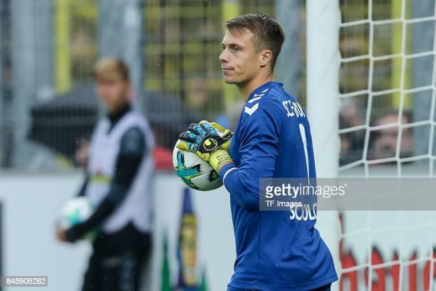 Goalkeeper Alexander Schwolow of Freiburg looks on during the Bundesliga match between SportClub Freiburg and Borussia Dortmund at SchwarzwaldStadion...