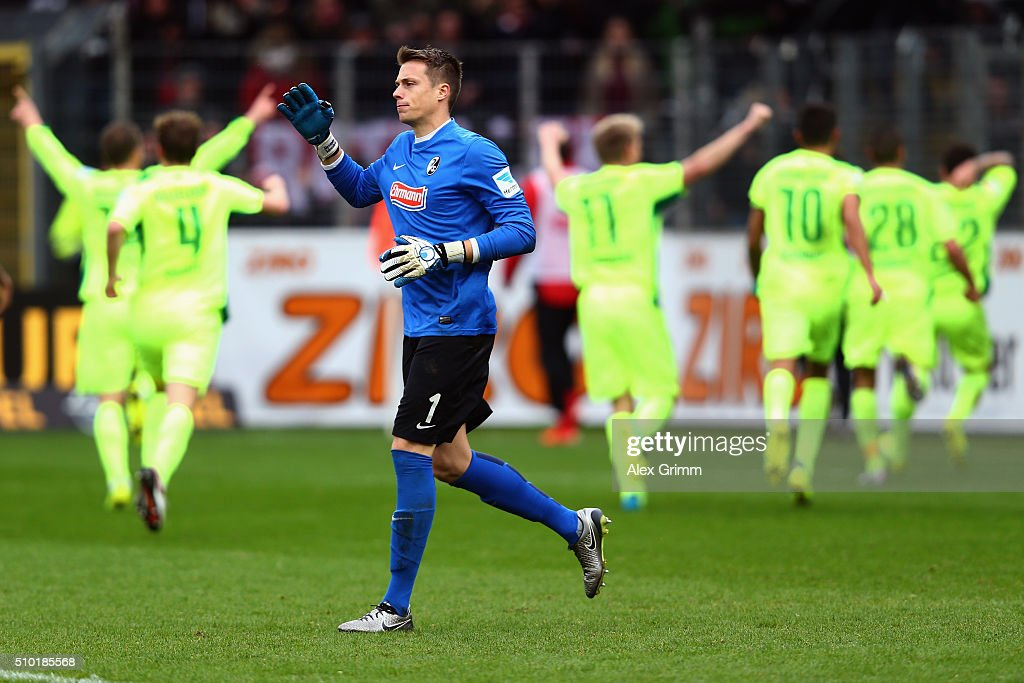 Goalkeeper Alexander Schwolow of Freiburg reacts as Sercan Sararer of Duesseldorf celebrates his team's second goal with team mates during the Second Bundesliga match between SC Freiburg and Fortuna Duesseldorf at Schwarzwald-Stadion on February 14, 2016 in Freiburg im Breisgau, Germany.