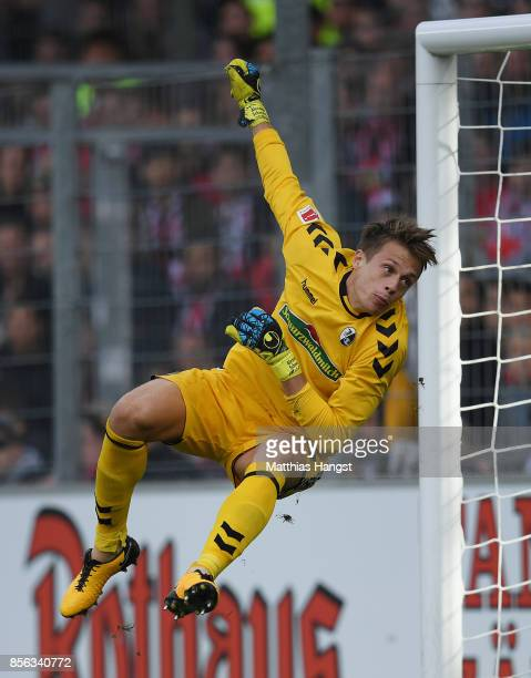 Goalkeeper Alexander Schwolow of Freiburg saves a ball during the Bundesliga match between SportClub Freiburg and TSG 1899 Hoffenheim at...