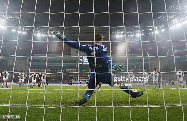 Goalkeeper Alexander Schwolow of Freiburg saves a penalty from Javier Hernandez of Leverkusen during the Bundesliga match between Bayer 04 Leverkusen...