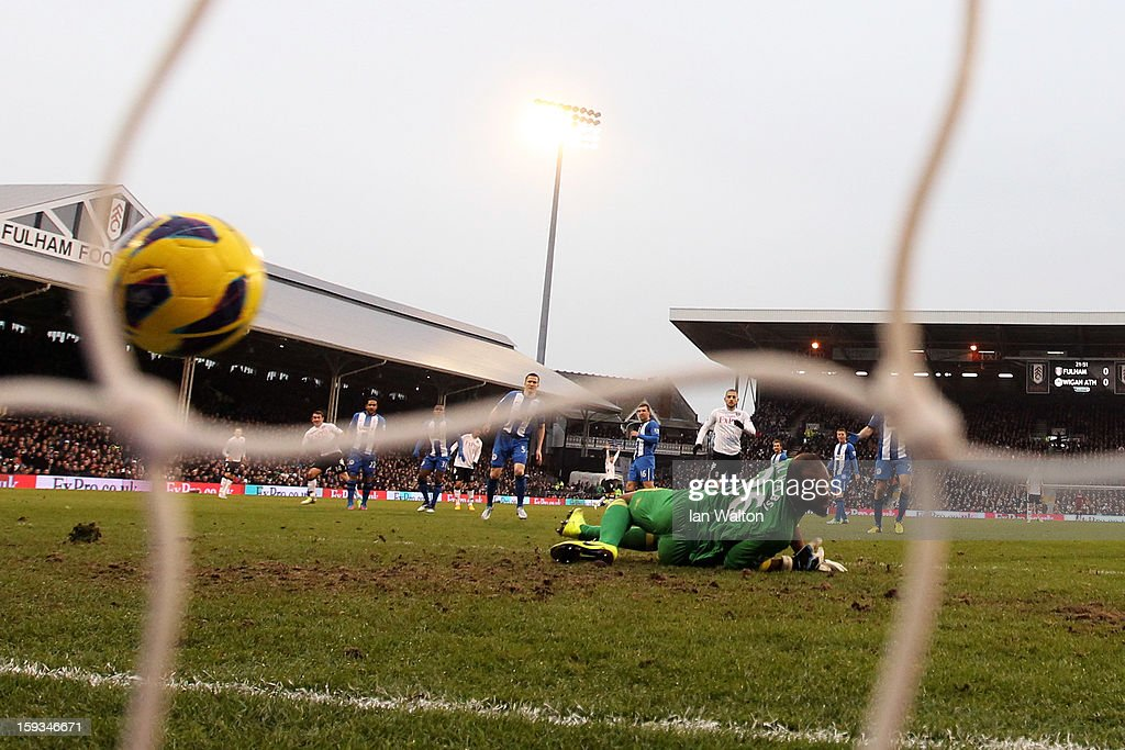 Goalkeeper <a gi-track='captionPersonalityLinkClicked' href=/galleries/search?phrase=Ali+Al+Habsi&family=editorial&specificpeople=1029315 ng-click='$event.stopPropagation()'>Ali Al Habsi</a> of Wigan looks on after <a gi-track='captionPersonalityLinkClicked' href=/galleries/search?phrase=Giorgos+Karagounis&family=editorial&specificpeople=240229 ng-click='$event.stopPropagation()'>Giorgos Karagounis</a> (L) of Fulham scores the opening goal past him during the Barclays Premier League match between Fulham and Wigan Athletic at Craven Cottage on January 12, 2013 in London, England.