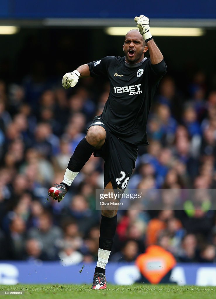 Goalkeeper Ali Al-Habsi of Wigan Athletic celebrates the goal scored by Mohamed Diame during the Barclays Premier League match between Chelsea and Wigan Athletic at Stamford Bridge on April 7, 2012 in London, England.