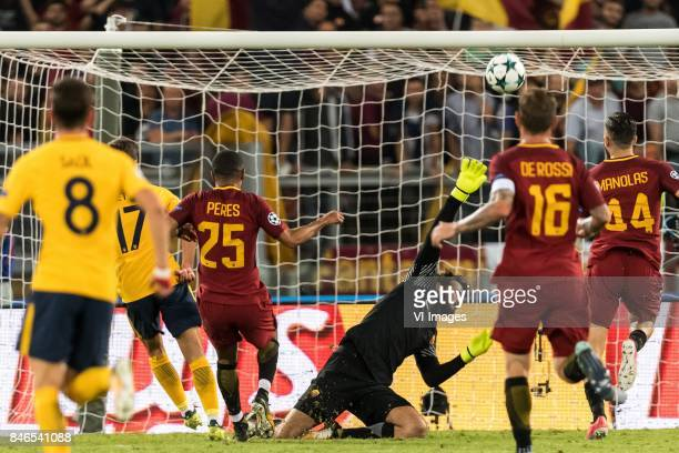 goalkeeper Alisson Becker of AS Roma saves during the UEFA Champions League group C match match between AS Roma and Atletico Madrid on September 12...
