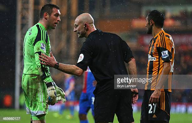 Goalkeeper Allan McGregor of Hull City is sent off by referee Roger East during the Barclays Premier League match between Crystal Palace and Hull...