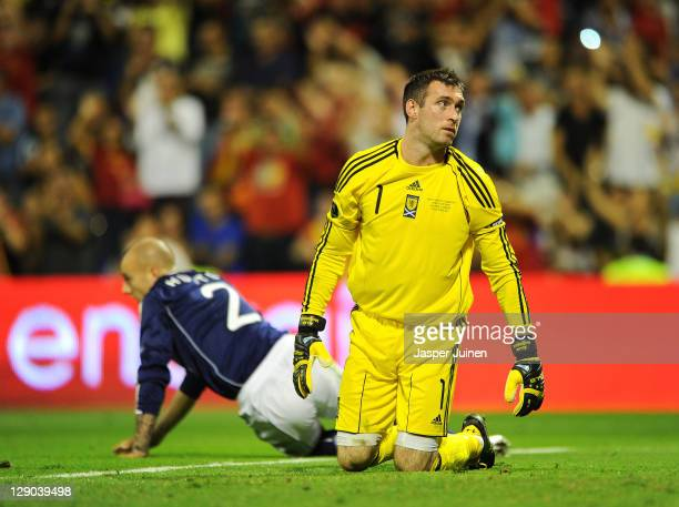 Goalkeeper Allan McGregor of Scotland reacts after conceding his sides third goal backdropped by his teammate Alan Hutton of Scotland during the UEFA...
