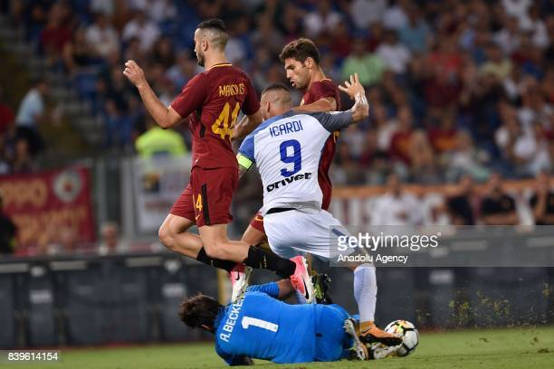 Goalkeeper Allison Ramses Becke of AS Roma in action against Mauro Icardi of FC Intenational Milano during Italian Serie A soccer match between AS...