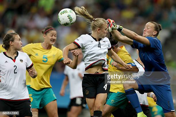 Goalkeeper Almuth Schult makes in front of teammate Leonie Maier of Germany in the Women's First Round Group F match at Arena Corinthians on August 6...