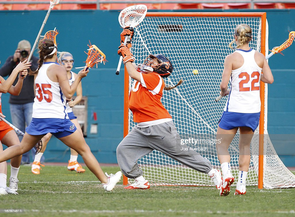 Goalkeeper Alyssa Costantino #30 of the Syracuse Orange is unable to stop the shot by Gabi Wiegand #35 of the Florida Gators during the 2013 Orange Bowl Lacrosse Classic on March 2, 2013 at SunLife Stadium in Miami Gardens, Florida.