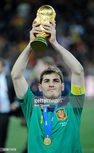 Goalkeeper and captain Iker Casillas of Spain holds aloft the World Cup after the 2010 FIFA World Cup Final between the Netherlands and Spain on July...
