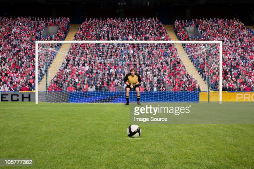 Goalkeeper and football : Stock Photo