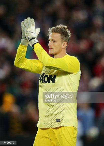 Goalkeeper Anders Lindegaard of Manchester United acknowledges the crowd at fulltime during the match between the ALeague AllStars and Manchester...