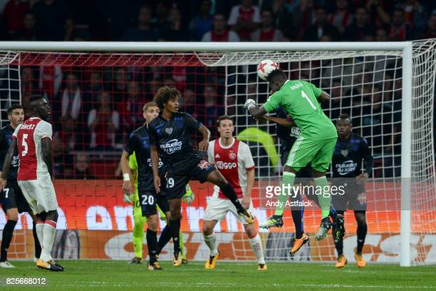 AJAX goalkeeper Andre Onana from AJAX heads the ball in the OSC Nice goal box during the UEFA Champions League Qualifying Third Round Second Leg...