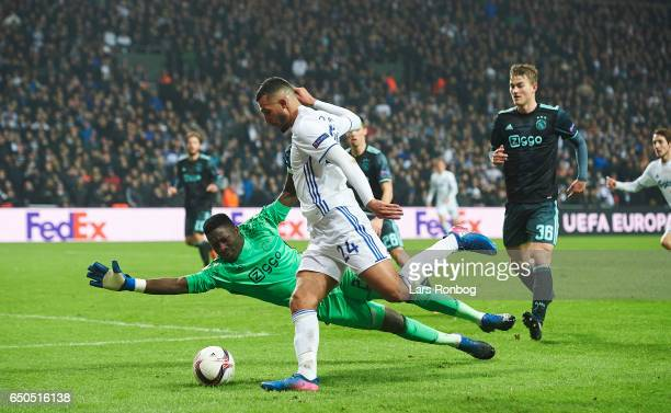 Goalkeeper Andre Onana of Ajax Amsterdam and Youssef Toutouh of FC Copenhagen compete for the ball during the UEFA Europa League Round of 16 First...