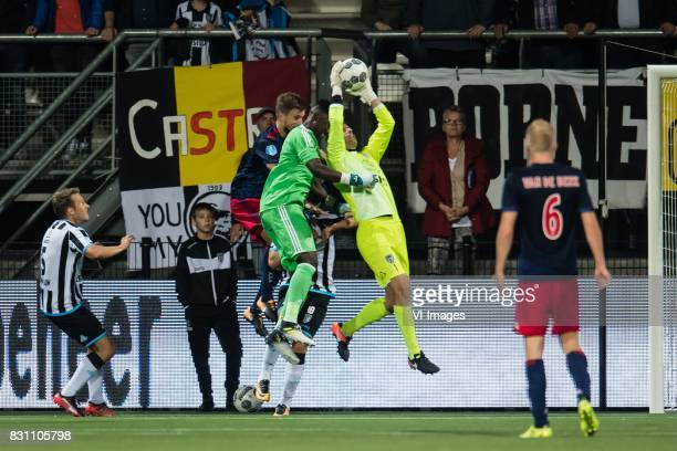 goalkeeper Andre Onana of Ajax goalkeeper Bram Castro of Heracles Almelo during the Dutch Eredivisie match between Heracles Almelo and Ajax Amsterdam...