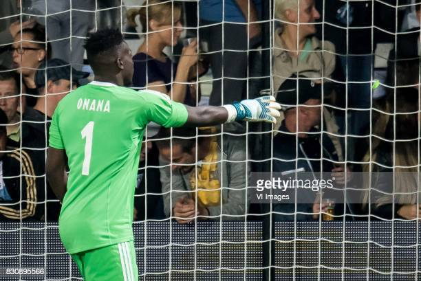 goalkeeper Andre Onana of Ajax throws away a lighter during the Dutch Eredivisie match between Heracles Almelo and Ajax Amsterdam at Polman stadium...