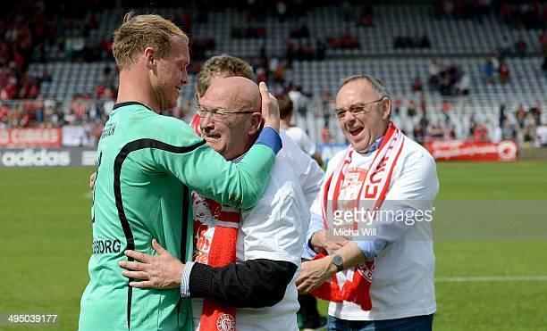 Goalkeeper Andre Poggenborg of Koeln hugs weeping club president of Koeln Klaus Ulonska during the second relegation leg between Bayern Muenchen II...
