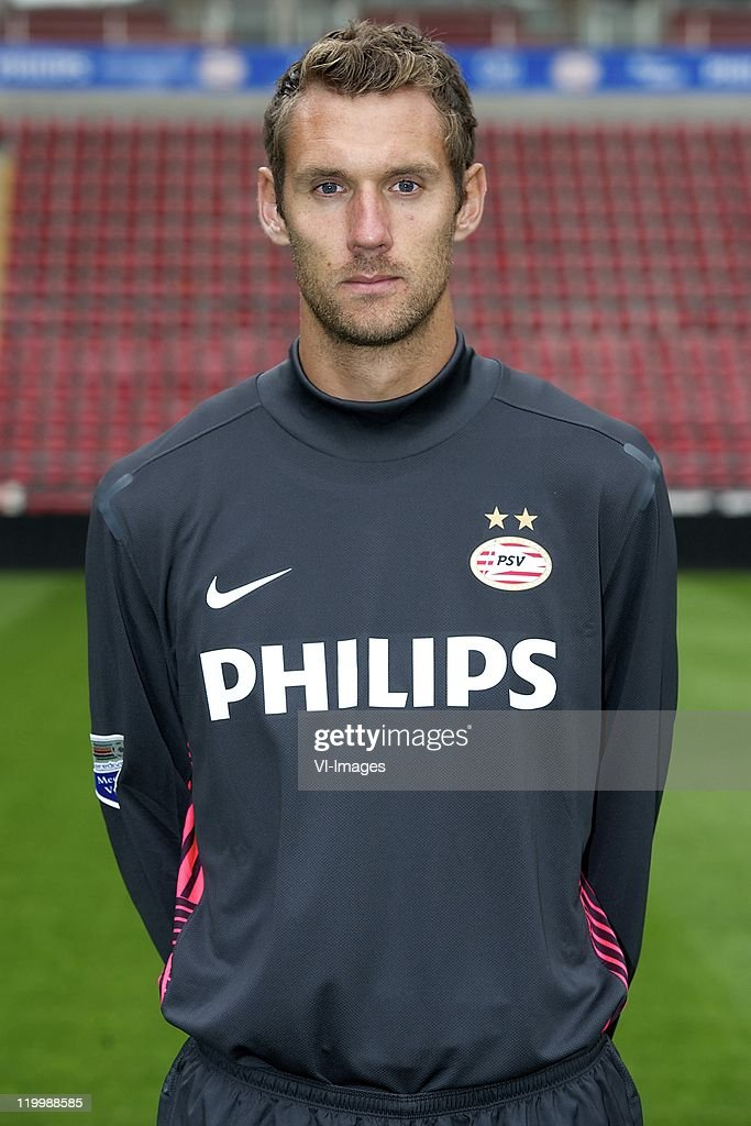 Goalkeeper <a gi-track='captionPersonalityLinkClicked' href=/galleries/search?phrase=Andreas+Isaksson&family=editorial&specificpeople=542896 ng-click='$event.stopPropagation()'>Andreas Isaksson</a> of PSV Eindhoven poses during a photocall held at the Philips Stadium on July 25, 2011 in Eindhoven, Netherlands.