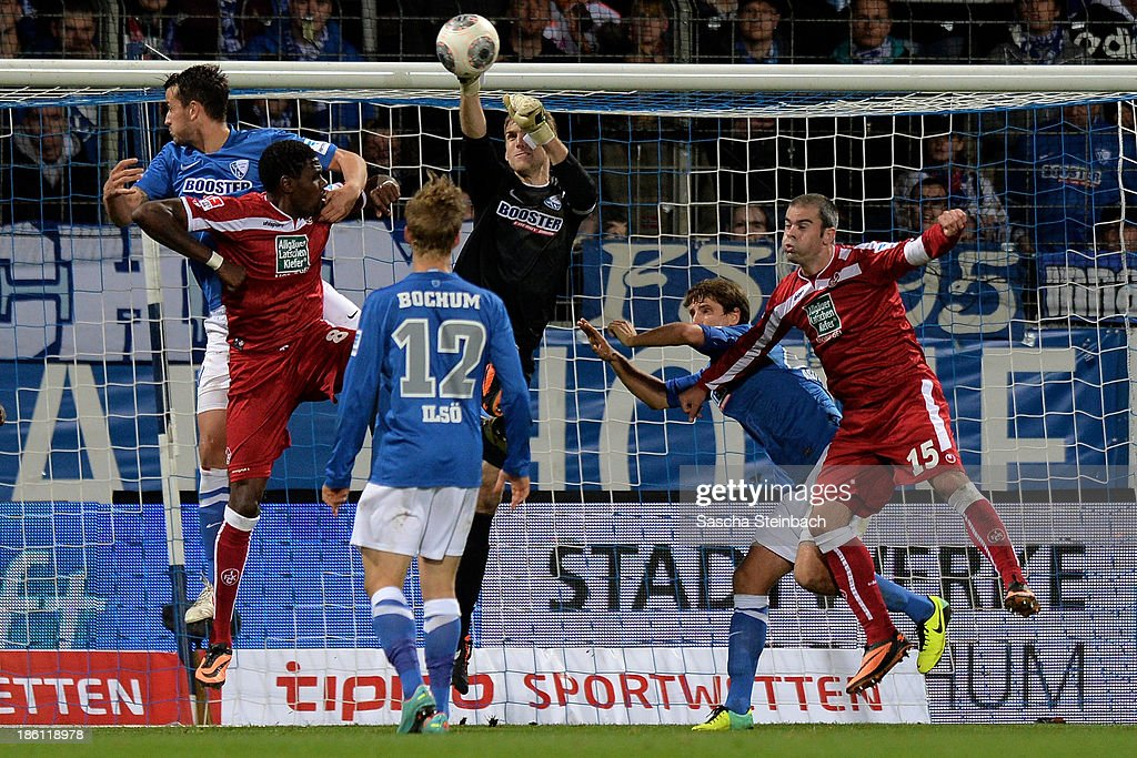 Goalkeeper Andreas Luthe (C) saves the ball during the Second Bundesliga match between VfL Bochum and 1. FC Kaiserslautern at Rewirpower Stadion on October 28, 2013 in Bochum, Germany.