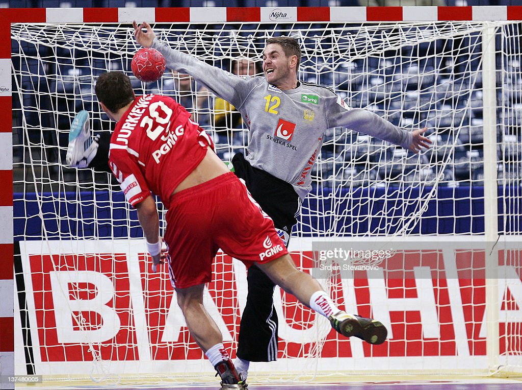 Goalkeeper Andreas Palicka (R) of Sweden stops a shot by Mariusz Jurkiewicz (L) of Poland, during the Men's European Handball Championship 2012 main group 1 match between Poland and Sweden, at Belgrade Arena Hall on January 21, 2011 in Belgrade, Serbia.