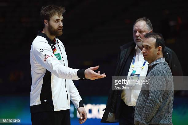 Goalkeeper Andreas Wolff of Germany discusses with Andreas Michelmann President of the German Handball Federation DHB and DHB Vice President Bob...