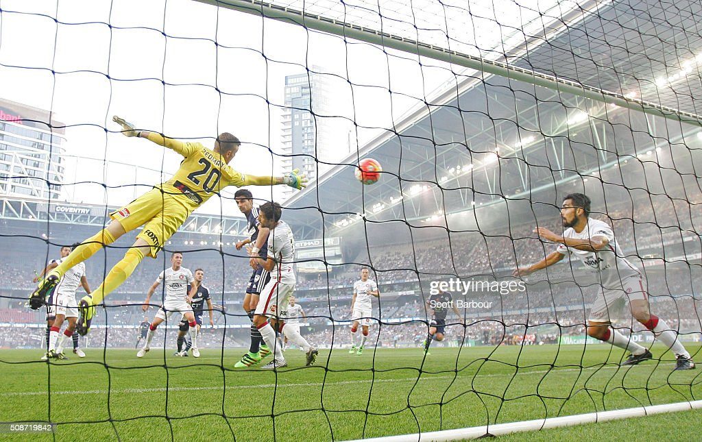 Goalkeeper Andrew Redmayne of the Wanderers dives but can't stop the shot of Besart Berisha of the Victory from scoring the first goal during the round 18 A-League match between the Melbourne Victory and Western Sydney Wanderers at Etihad Stadium on February 6, 2016 in Melbourne, Australia.