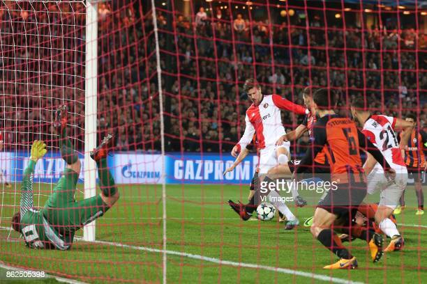 Goalkeeper Andriy Pyatov of FC Shakhtar Donetsk Michiel Kramer of Feyenoord during the UEFA Champions League group F match between Feyenoord...