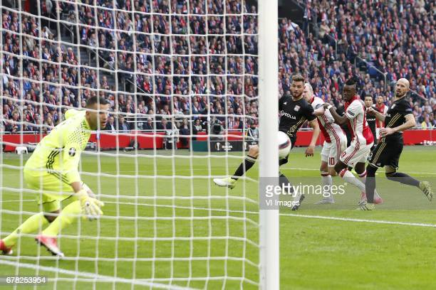 goalkeeper Anthony Lopes of Olympique Lyonnais Lucas Tousart of Olympique Lyonnais Davy Klaassen of Ajax Bertrand Traore of Ajax Christophe Jallet of...