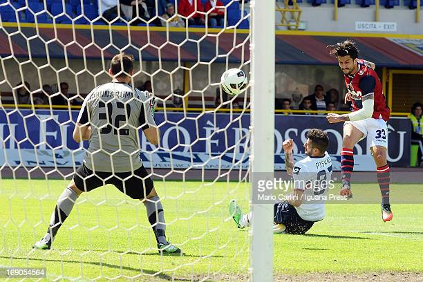 Goalkeeper Antonio Donnarumma defends against a shot at goal by Panagiotis Kone of Bologna FC during the Serie A match between Bologna FC and Genoa...