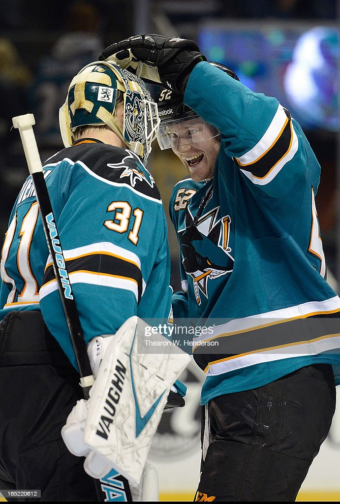 Goalkeeper <a gi-track='captionPersonalityLinkClicked' href=/galleries/search?phrase=Antti+Niemi&family=editorial&specificpeople=213913 ng-click='$event.stopPropagation()'>Antti Niemi</a> #31 and Matt Irwin #52 of the San Jose Sharks celebrate defeating the Vancouver Canucks 3-2 at HP Pavilion on April 1, 2013 in San Jose, California.