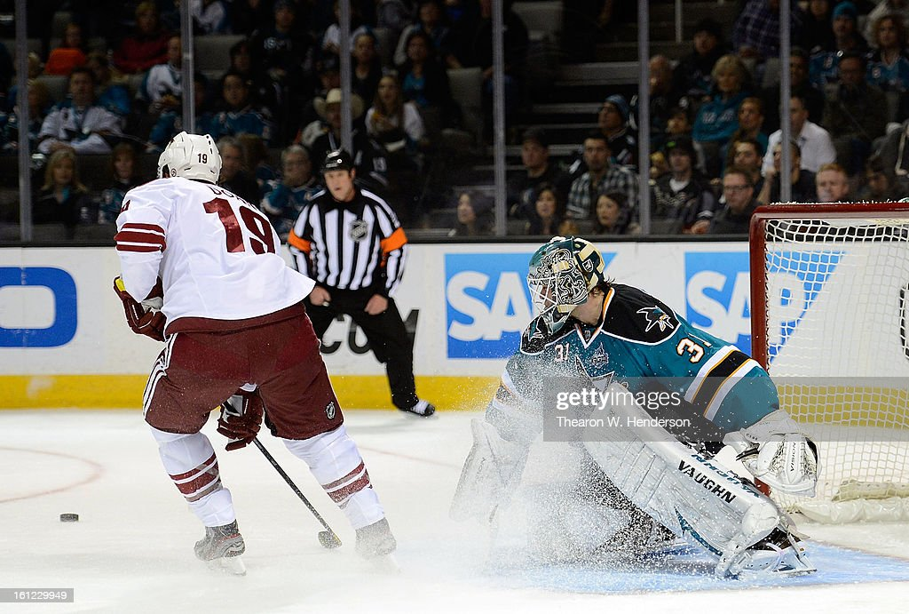 Goalkeeper Antti Niemi #31 of the San Jose Sharks blocks a shot with his stick knocking the puck away from Shane Doan #19 of the Phoenix Coyotes in the first period at HP Pavilion on February 9, 2013 in San Jose, California.