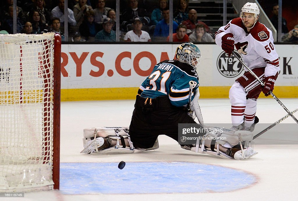 Goalkeeper <a gi-track='captionPersonalityLinkClicked' href=/galleries/search?phrase=Antti+Niemi&family=editorial&specificpeople=213913 ng-click='$event.stopPropagation()'>Antti Niemi</a> #31 of the San Jose Sharks blocks the shot of <a gi-track='captionPersonalityLinkClicked' href=/galleries/search?phrase=Antoine+Vermette&family=editorial&specificpeople=206302 ng-click='$event.stopPropagation()'>Antoine Vermette</a> #50 of the Phoenix Coyotes in the third period at HP Pavilion on March 30, 2013 in San Jose, California. The Sharks won the game 3-2 in an overtime shoot-out.