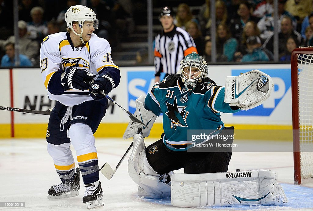 Goalkeeper Antti Niemi #31 of the San Jose Sharks defends his goal against Colin Wilson #33 of the Nashville Predators at HP Pavilion on February 2, 2013 in San Jose, California.