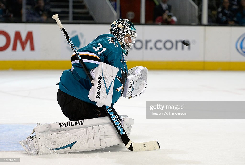 Goalkeeper <a gi-track='captionPersonalityLinkClicked' href=/galleries/search?phrase=Antti+Niemi&family=editorial&specificpeople=213913 ng-click='$event.stopPropagation()'>Antti Niemi</a> #31 of the San Jose Sharks defends his goal agaisnst the Toronto Maple Leafs during the third period at SAP Center on March 11, 2014 in San Jose, California.