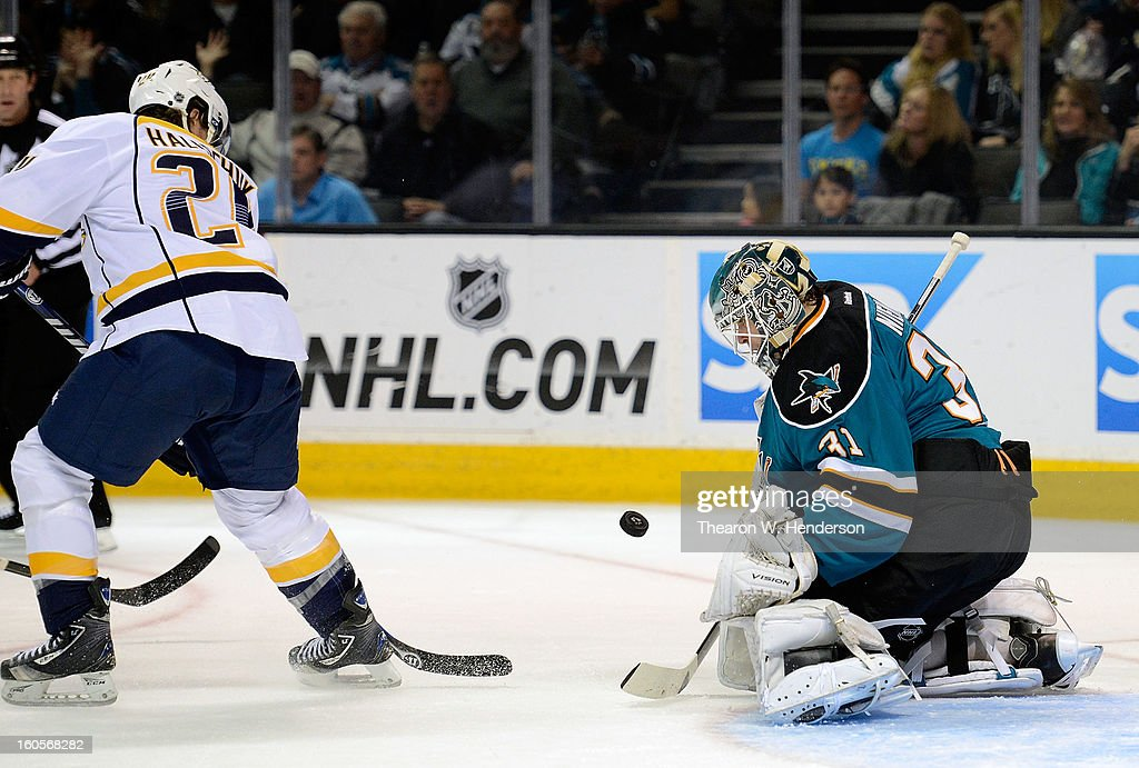 Goalkeeper Antti Niemi #31 of the San Jose Sharks deflects the shot of Matt Halischuk #24 of the Nashville Predators away from the goal in the first period at HP Pavilion on February 2, 2013 in San Jose, California.