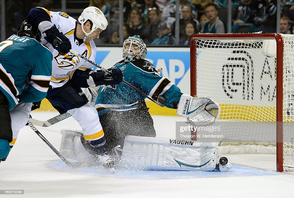 Goalkeeper Antti Niemi #31 of the San Jose Sharks deflects the shot of David Legwand #11 of the Nashville Predators away from the goal in the third period at HP Pavilion on February 2, 2013 in San Jose, California. The Predators won the game in an overtime shoot-out 2-1.