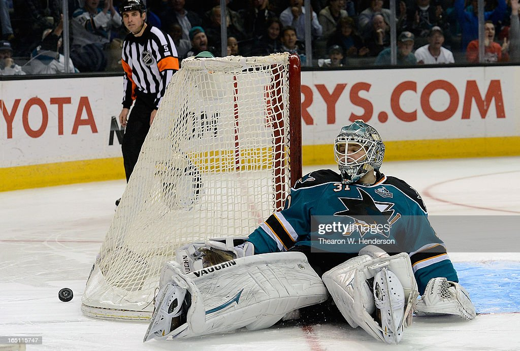 Goalkeeper <a gi-track='captionPersonalityLinkClicked' href=/galleries/search?phrase=Antti+Niemi&family=editorial&specificpeople=213913 ng-click='$event.stopPropagation()'>Antti Niemi</a> #31 of the San Jose Sharks kicks the puck away from the net, blocking the shot of Radim Vrbata #17 of the Phoenix Coyotes in a overtime shoot-out at HP Pavilion on March 30, 2013 in San Jose, California. The Sharks won the game 3-2 in the overtime shoot-out.