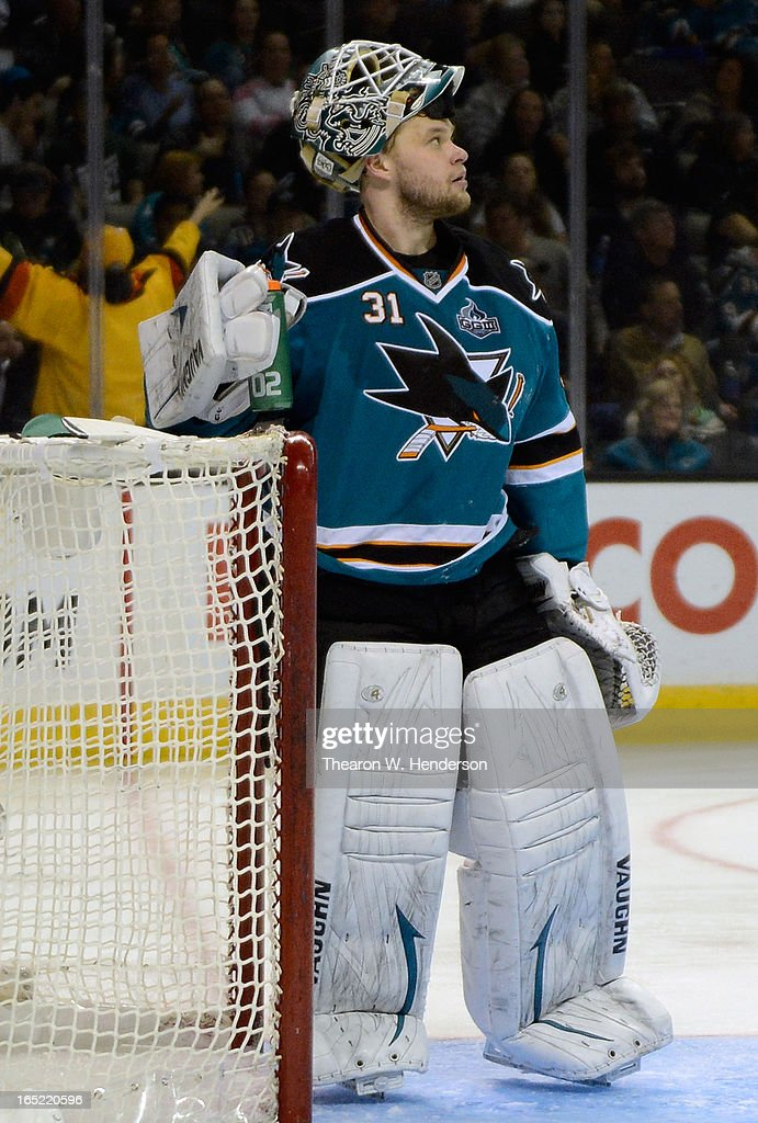 Goalkeeper <a gi-track='captionPersonalityLinkClicked' href=/galleries/search?phrase=Antti+Niemi&family=editorial&specificpeople=213913 ng-click='$event.stopPropagation()'>Antti Niemi</a> #31 of the San Jose Sharks looks up at the scoreboard after he gave up a goal to Alexandre Burrows #14 of the Vancouver Canucks in the third period at HP Pavilion on April 1, 2013 in San Jose, California. The Sharks won the game 3-2.