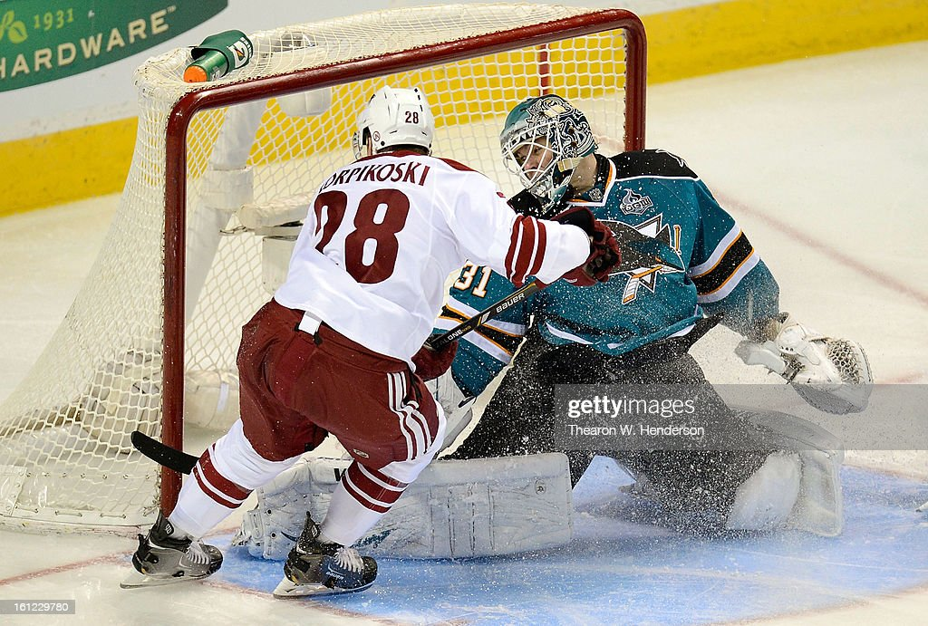 Goalkeeper Antti Niemi #31 of the San Jose Sharks makes a kick save of the shot off the stick of Lauri Korpikoski #28 of the Phoenix Coyotes in the third period at HP Pavilion on February 9, 2013 in San Jose, California. The Coyotes won the game 1-0 in an overtime shoot-out.