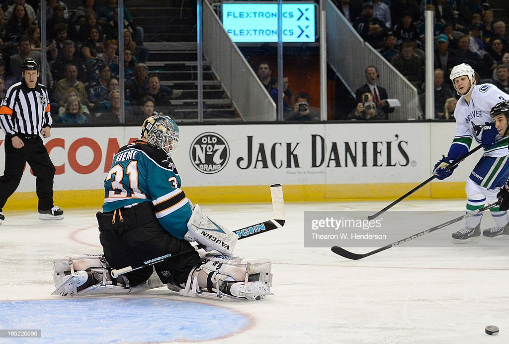 Goalkeeper <a gi-track='captionPersonalityLinkClicked' href=/galleries/search?phrase=Antti+Niemi&family=editorial&specificpeople=213913 ng-click='$event.stopPropagation()'>Antti Niemi</a> #31 of the San Jose Sharks makes a save kicking the puck away from the goal against the Vancouver Canucks in the third period at HP Pavilion on April 1, 2013 in San Jose, California. The Sharks won the game 3-2.