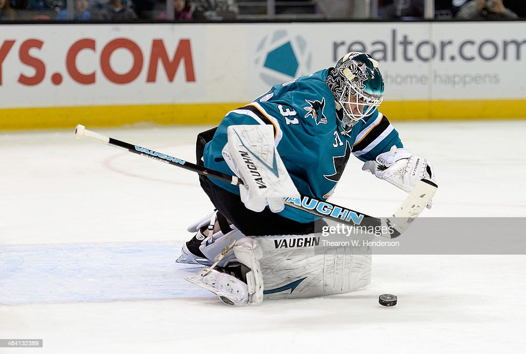 Goalkeeper <a gi-track='captionPersonalityLinkClicked' href=/galleries/search?phrase=Antti+Niemi&family=editorial&specificpeople=213913 ng-click='$event.stopPropagation()'>Antti Niemi</a> #31 of the San Jose Sharks makes a stick save against the Calgary Flames during the first period at SAP Center on January 20, 2014 in San Jose, California. The Sharks won the game 3-2.