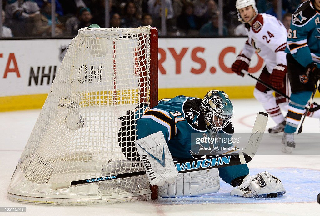Goalkeeper <a gi-track='captionPersonalityLinkClicked' href=/galleries/search?phrase=Antti+Niemi&family=editorial&specificpeople=213913 ng-click='$event.stopPropagation()'>Antti Niemi</a> #31 of the San Jose Sharks smothers the puck making a glove hand save against the Phoenix Coyotes in the third period at HP Pavilion on March 30, 2013 in San Jose, California. The Sharks won the game 3-2 in an overtime shoot-out.